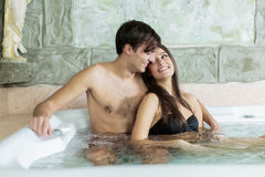 Young couple relaxing in hot tub Royalty Free Stock Image