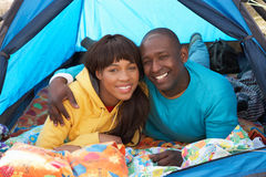Young Couple Relaxing Inside Tent On Holiday Stock Photos