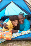 Young Couple Relaxing Inside Tent On Holiday. Young Couple Relaxing Inside Tent On Camping Holiday stock photos