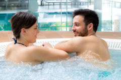 Young couple relaxing in jacuzzi. Royalty Free Stock Images