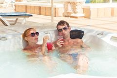 Young couple relaxing in jacuzzi pool Royalty Free Stock Image