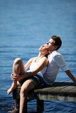 Young couple relaxing by the lake Royalty Free Stock Photo
