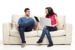 Young couple relaxing with laptop book Royalty Free Stock Photo
