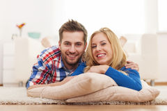 Young couple relaxing in living room Royalty Free Stock Photo