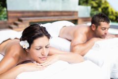 Young couple relaxing on massage table Stock Image