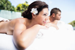 Young couple relaxing on massage table Royalty Free Stock Images
