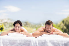 Young couple relaxing on massage table Stock Photo