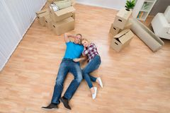 Young couple relaxing in new home Stock Photos