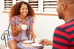 Young Couple Relaxing Outdoors And Drinking Coffee Royalty Free Stock Photo