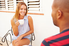 Young Couple Relaxing Outdoors And Drinking Coffee Royalty Free Stock Images