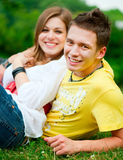 Young couple relaxing at the park stock photo