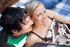 Young couple relaxing on picnic blanket. Top view close-up of young man and woman relaxing on picnic blanket royalty free stock image