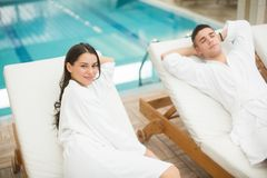 Young couple relaxing by pool Royalty Free Stock Photo