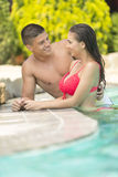 Young couple relaxing in the pool Stock Images