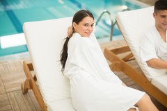 Young couple relaxing by the pool Stock Image