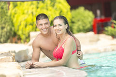 Young couple relaxing in the pool Royalty Free Stock Image