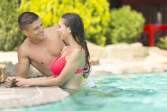 Young couple relaxing in the pool. View of the young couple relaxing in the pool Royalty Free Stock Photo