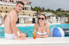 Young Couple Relaxing at Resort Swimming Pool Stock Images