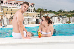Young Couple Relaxing at Resort Swimming Pool Stock Photos