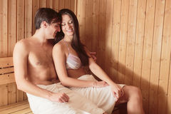 Young couple relaxing in sauna Stock Image