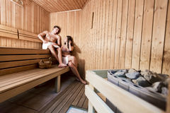 Young couple relaxing in sauna Royalty Free Stock Photo