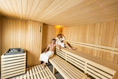 Young couple relaxing in the sauna Royalty Free Stock Images