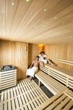 Young couple relaxing in the sauna Stock Photo