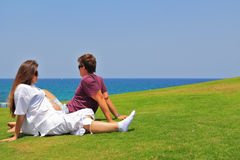 Young couple relaxing  by the sea Stock Photo