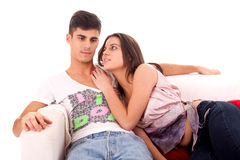 Young Couple relaxing on the sofa. Young beautiful couple relaxing and flirting on the sofa stock photos