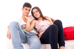 Young Couple relaxing on the sofa. Young beautiful couple relaxing and flirting on the sofa stock images