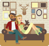 Young Couple Relaxing On Sofa Stock Images