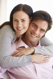 Young Couple Relaxing On Sofa Together At Home Royalty Free Stock Image