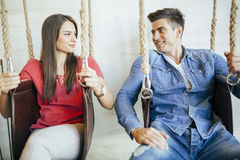 Young couple relaxing in swing Stock Photos