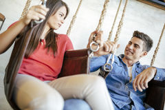 Young couple relaxing in swing Royalty Free Stock Photography