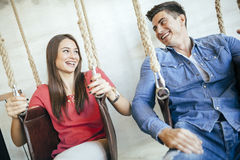 Young couple relaxing in swing Stock Photo