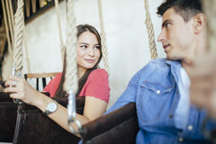 Young couple relaxing in swing Royalty Free Stock Photo