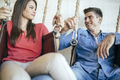 Young couple relaxing in swing Royalty Free Stock Photos