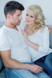 Young couple relaxing together on a sofa Royalty Free Stock Photos