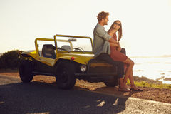 Young couple relaxing together on their road trip Royalty Free Stock Images