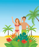 Young couple relaxing on a tropical beach. Stock Photo