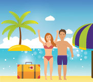 Young couple relaxing on a tropical beach. Royalty Free Stock Image