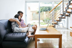 Young couple relaxing and watching movie at home Royalty Free Stock Photo