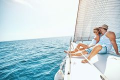 Young Couple Relaxing on a Yacht stock photos