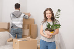 Young couple relocating to new apartment and unpacking boxes. Stock Photography