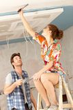Young couple renovating home Stock Images