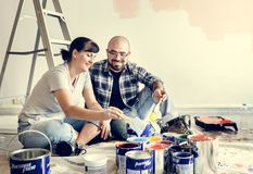 Young couple renovating the house royalty free stock image