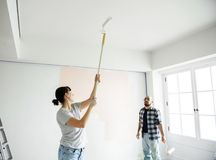 Young couple renovating the house DIY concept royalty free stock photo