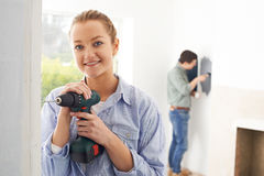 Young Couple Renovating Property Together. Happy Couple Renovating Property Together Stock Photography