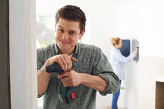 Young Couple Renovating Property Together. Portrait Of Couple Renovating Property Together Stock Images