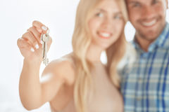 Young couple rent apartment together real estate. Young couple rent apartment together in the office holding keys Stock Images